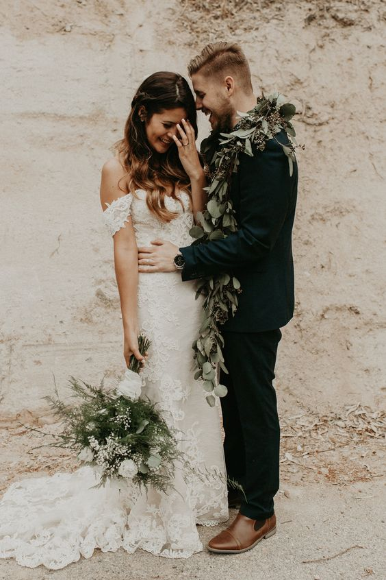 off the shoulder lace wedding gown with a train is very fashionable and looks super romantic