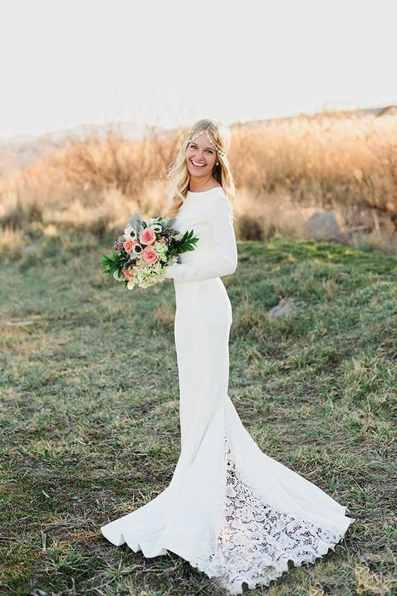 a plain modern mermaid wedding gown with long sleeves, a high neckline and a lace train