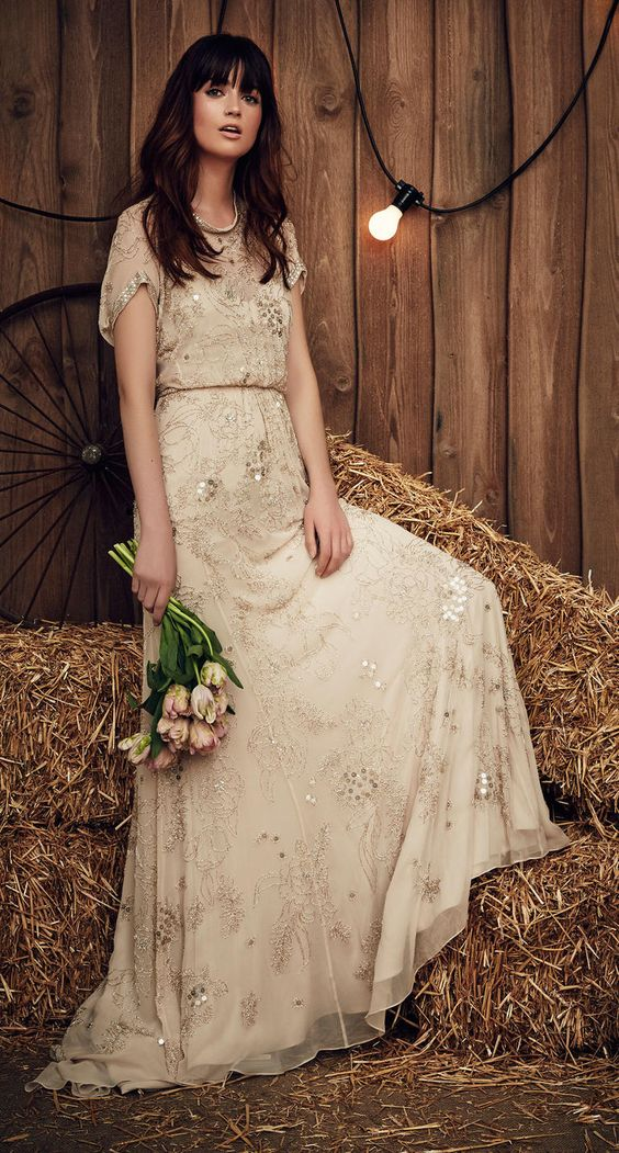 a champagne wedding gown with short sleeves and embellishements for a boho bride
