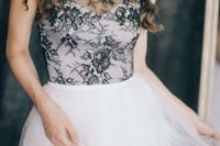 22 a cream sweetheart neckline wedding dress with a black lace sleeveless top