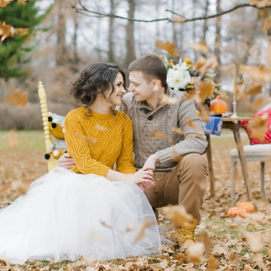 a patterned mustard half sleeve sweater over the wedding dress to add color