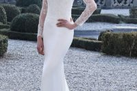 22 a plain strapless mermaid wedding gown with a sheer lace embellished top with long sleeves over it