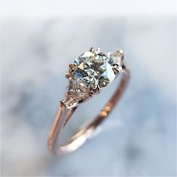 a rose gold engagement ring with a round diamond and no halo looks more modern