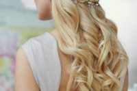 22 a wavy and twisted half updo on long hair with a gorgeous rhinestone hairpiece