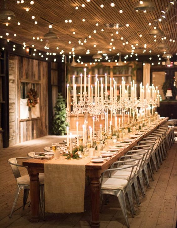 crystal candlabras with candles and candles in smaller candle holders create a fantastic lit up ambience