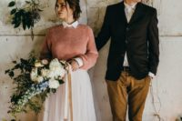 23 a peachy pink sweater over a pink high neckline wedding dress for a colorful touch