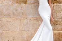 23 an elegant bateau neckline plain modern dress with a train and embellishments