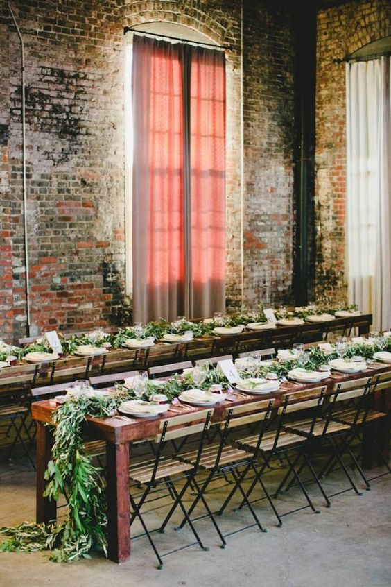 cover the windows with curtains that fit your wedding color scheme and add greenery garlands