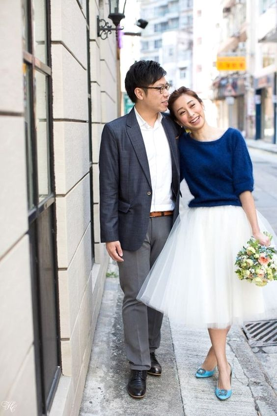 a navy cashmere sweater with half sleeves, a white tulle skirt and blue Manolo Blahnik shoes