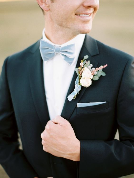 a pale blue velvet bow tie refreshes the classic tux look and gives it a spring feel