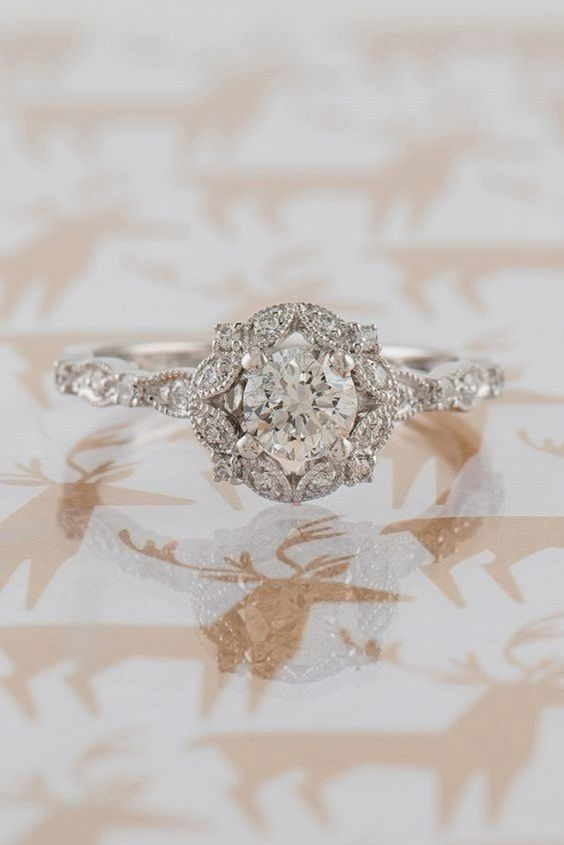 a vintage inspired round halo vintage diamond engagement ring for a romantic girl
