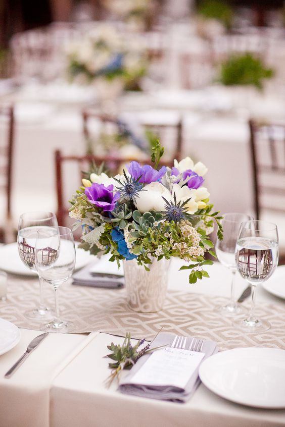 add some ultra violet blooms to a neutral floral centerpiece to make it trendier
