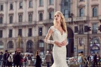 24 lace applique mermaid wedding gown with long illusion sleeves, a small train and a deep cut