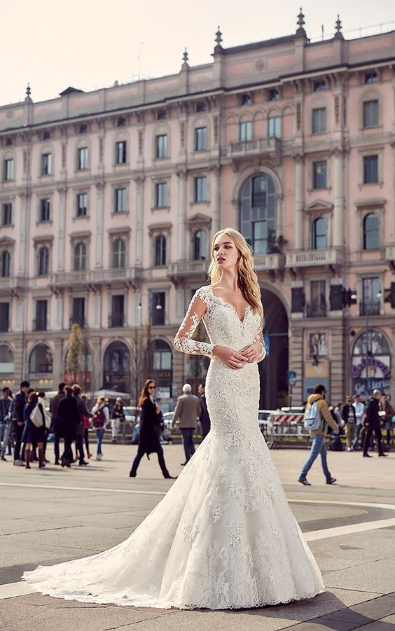 lace applique mermaid wedding gown with long illusion sleeves, a small train and a deep cut