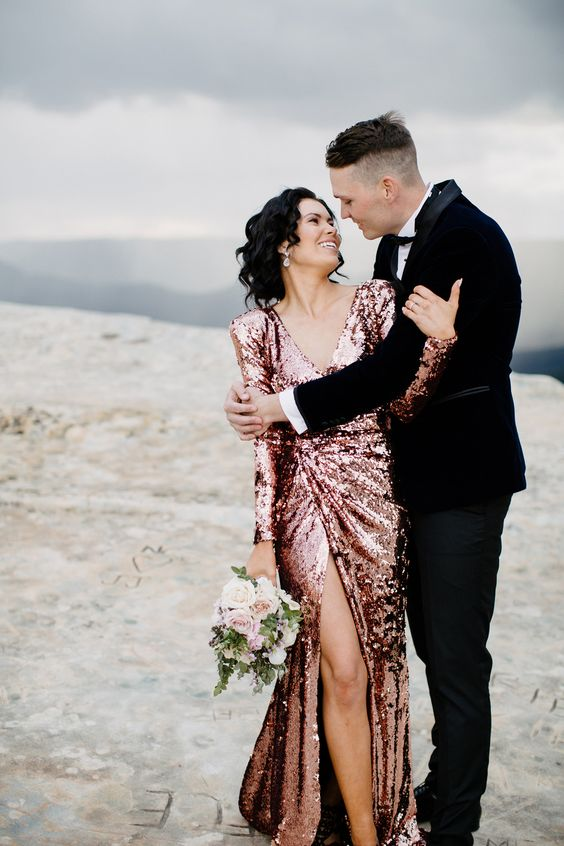 a rose sequin sheath wedding dress with long sleeves, a V neckline and a thigh high slit for a glam bride