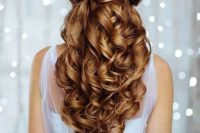 25 an elegant twisted and curly half updo accessorized with a shiny snowflake hairpiece