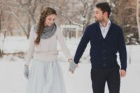 26 a blush sweater over a blue wedding gown, grey mittens and a scarf  for a pastel bridal look