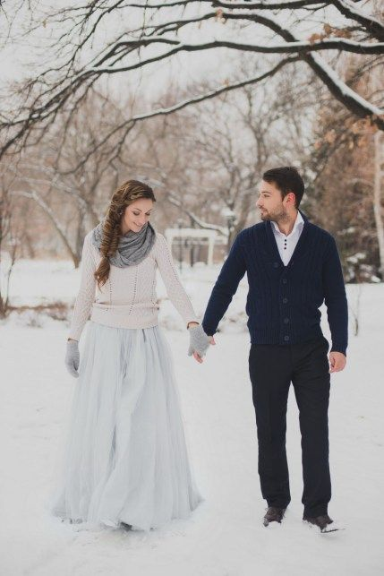 a blush sweater over a blue wedding gown, grey mittens and a scarf  for a pastel bridal look
