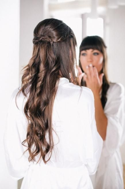 long wavy hair with twists and a fringe looks chic and rather casual