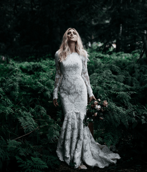 modest yet sexy lace mermaid wedding dress with long sleeves and a high neckline