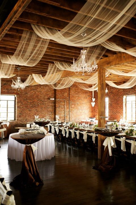 the reception space can be decorated with airy and liht fabric and glam chandeliers
