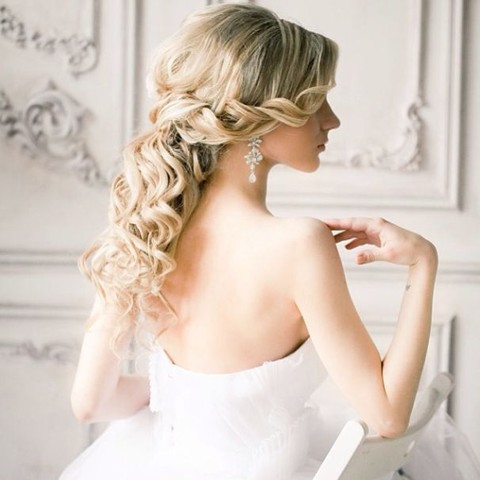 a romantic twisted and curly half updo for a formal or glam bridal look