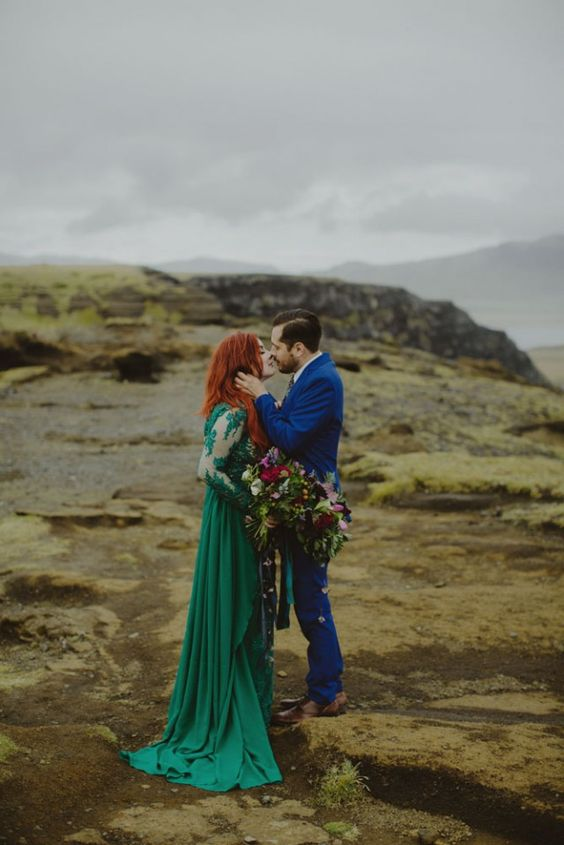 an emerald wedding dress with an illusion bodice, long sleeves and a flowy skirt to stand out in the scenery