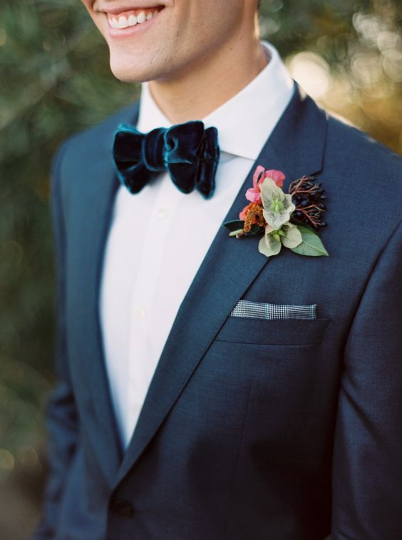 highlight your suit with a velvet bow tie of a deeper shade, for example, dark blue like here