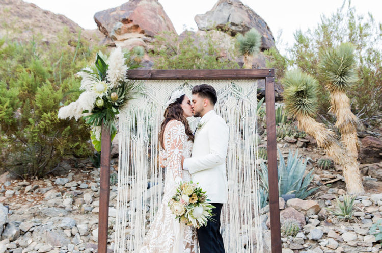 This desert boho wedding has a cool palete of neutrals and greenery and took place in California
