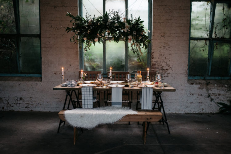 This winter wedding shoot took place in a derelict factory, was filled with chic industrial touches and wild styled florals