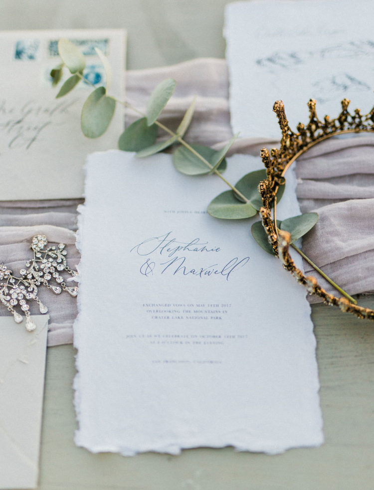 Icy blue stationery with a raw edge is a great idea for any snowy wedding