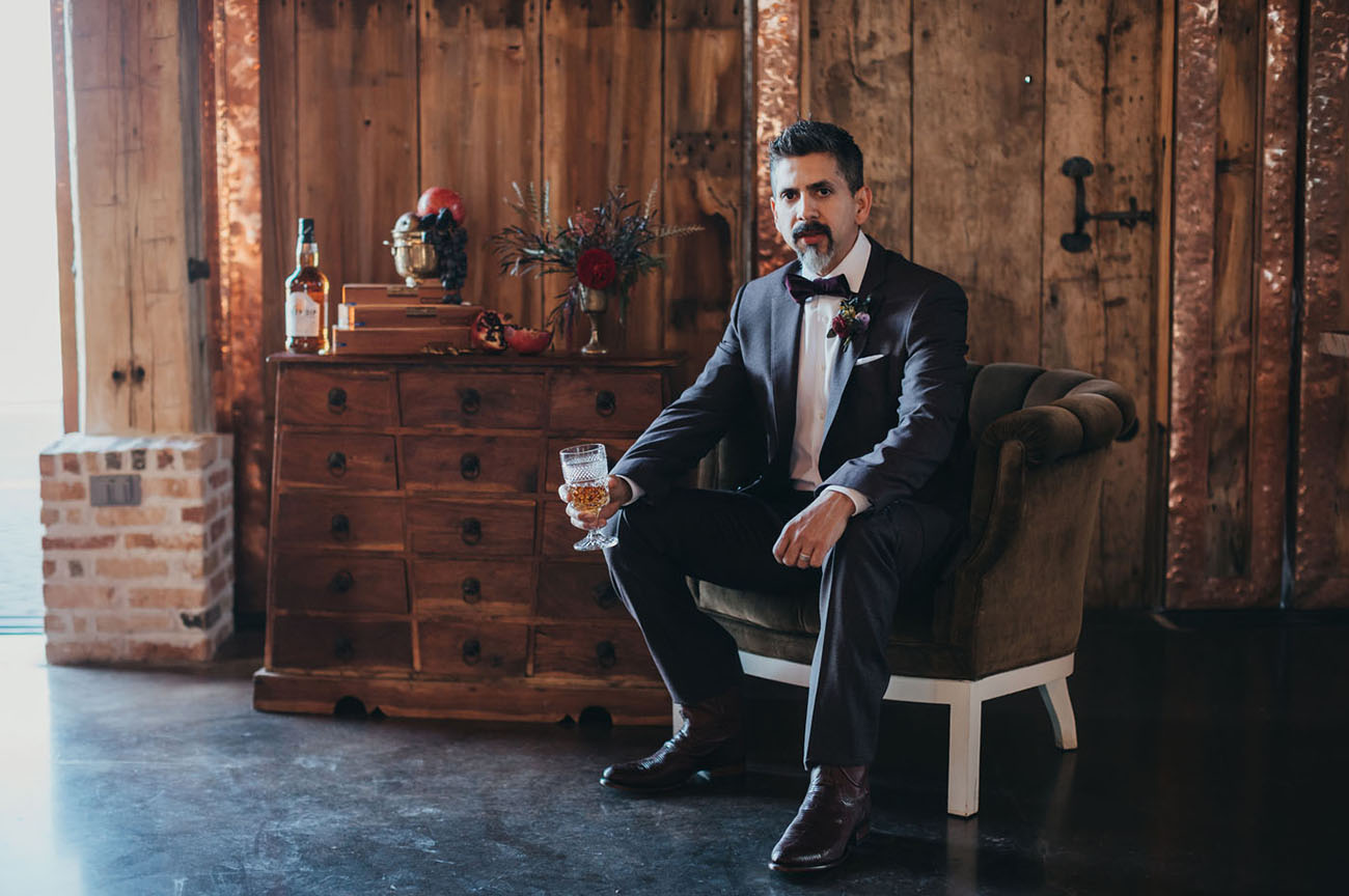 The groom was wearing a dark brown suit by Hugo Boss, a velvet bow tie and matching boots