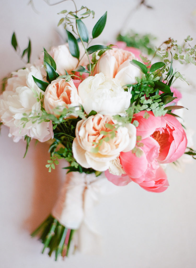 The wedding bouquet with greenery, blush and hot pink blooms
