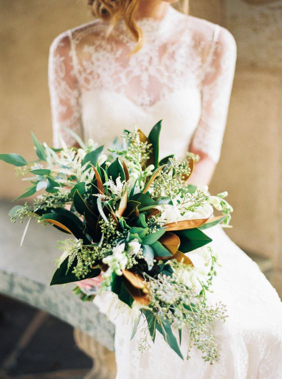 a bridal bouquet with magnolia leaves and eucalyptus for a trendy greenery bouquet
