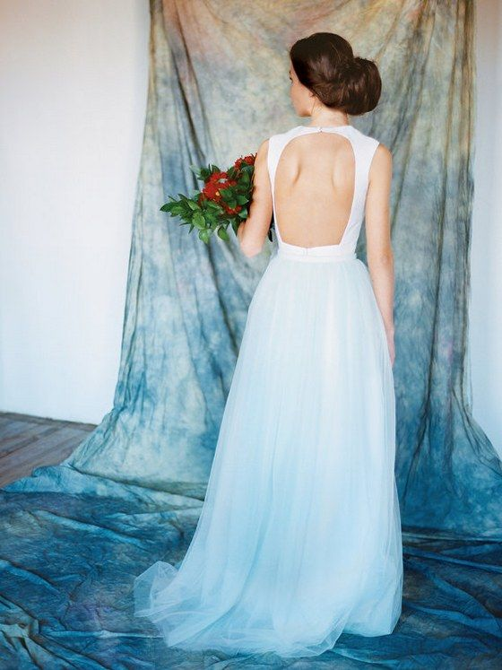 a sleeveless cutout back A-line wedding dress with an ombre blue skirt for a coastal or seaside bride