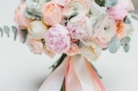 02 coral and pink wedding bouquet with pale eucalyptus and ribbons looks very chic