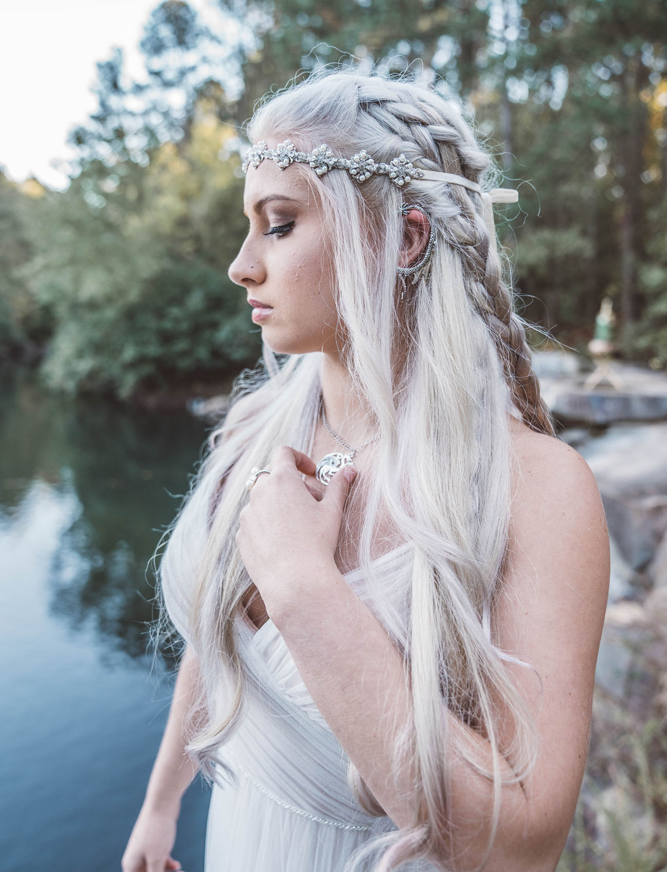 She was rocking a half up braided hairstyle with a chic headpiece and various dragon inspired accessories
