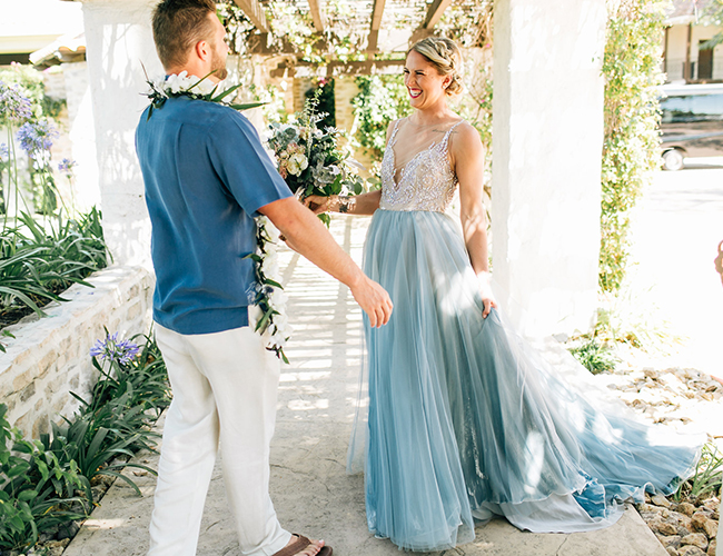The bride was wearing a beautiful illusion back and neckline wedding dress with an embellished bodice and an aqua blue skirt