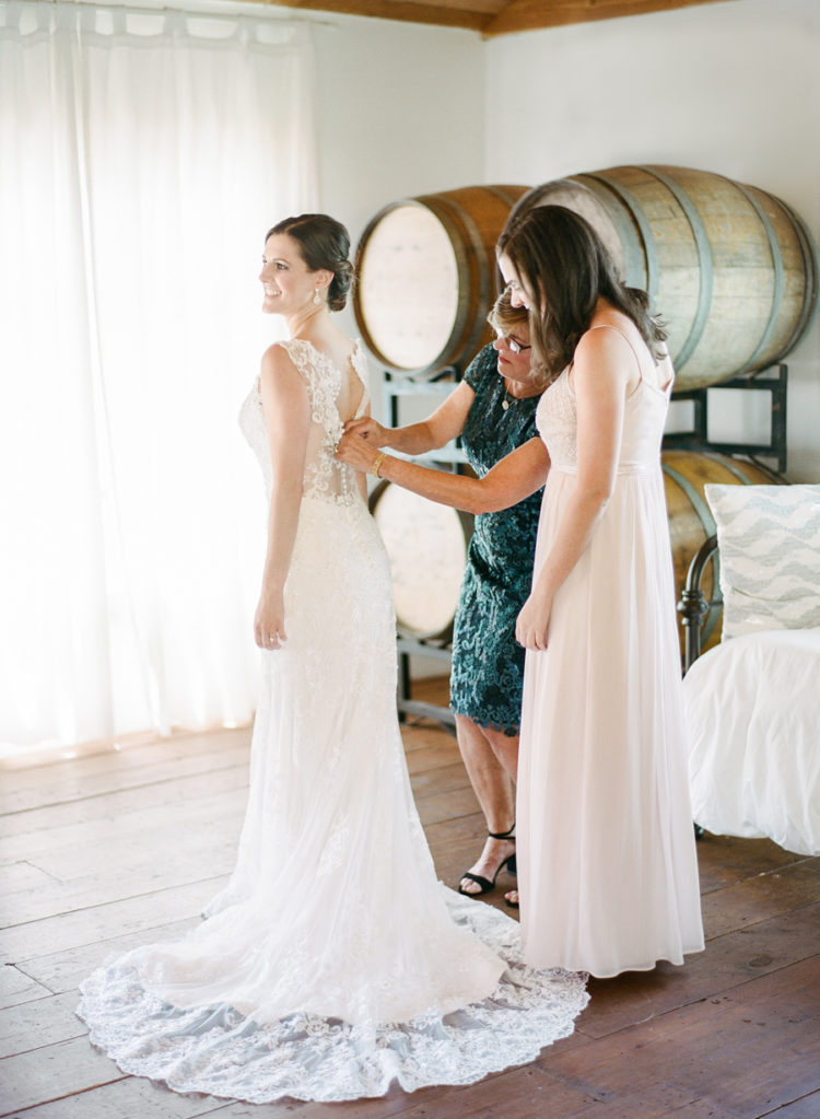 The bride was wearing a sleeveless illusion back wedding dress and diamond earrings for a statement