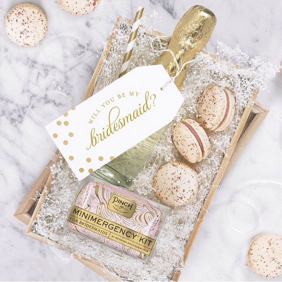 a champagne bottle, metallic touch macarons and a little emergency kit to rock