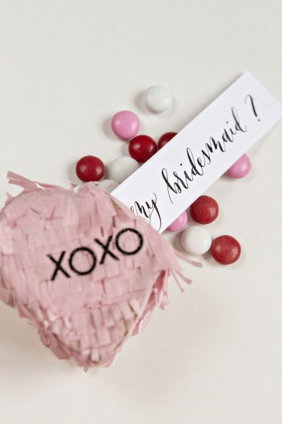 a cute blush pinata filled with candies to pop up the question