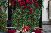 03 a living wall with lush black and burgundy blooms and a matching greenery runner on the table