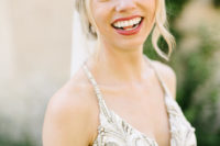 04 She chose a gorgeous wedding dress with spaghetti straps and a heavily embellished bodice