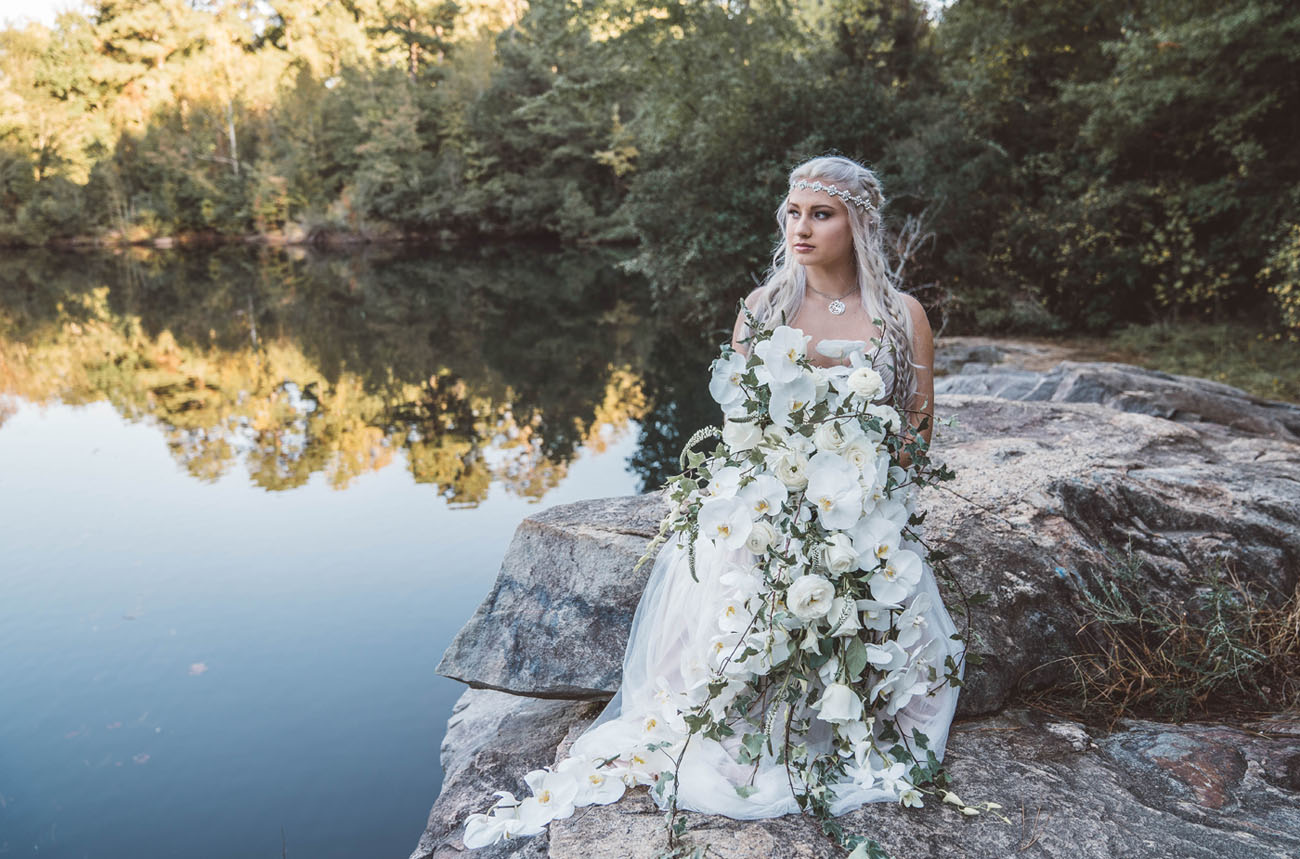 The bride was holding a cascading lush white orchid bouquet
