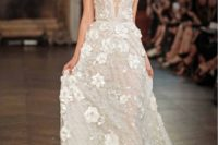 04 embellished wedding dress with shimmering beadwork, a covered plunging neckline and 3D floral appliqués