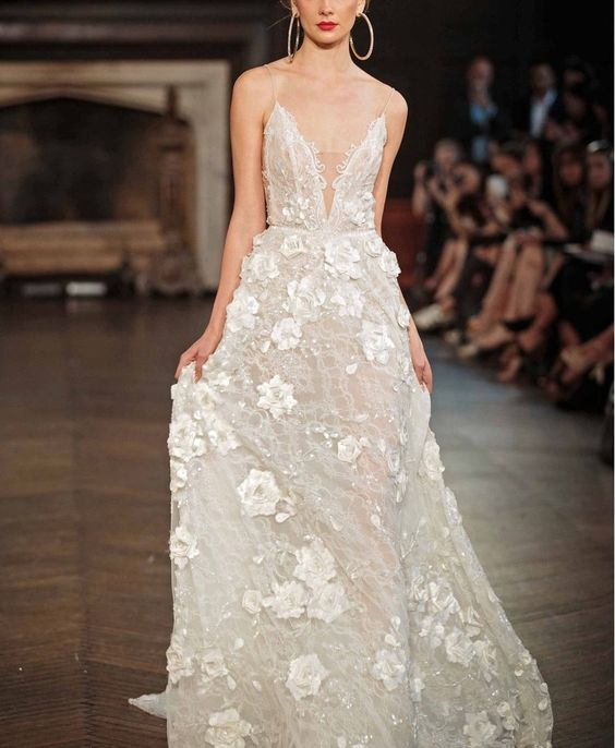 embellished wedding dress with shimmering beadwork, a covered plunging neckline and 3D floral appliqués