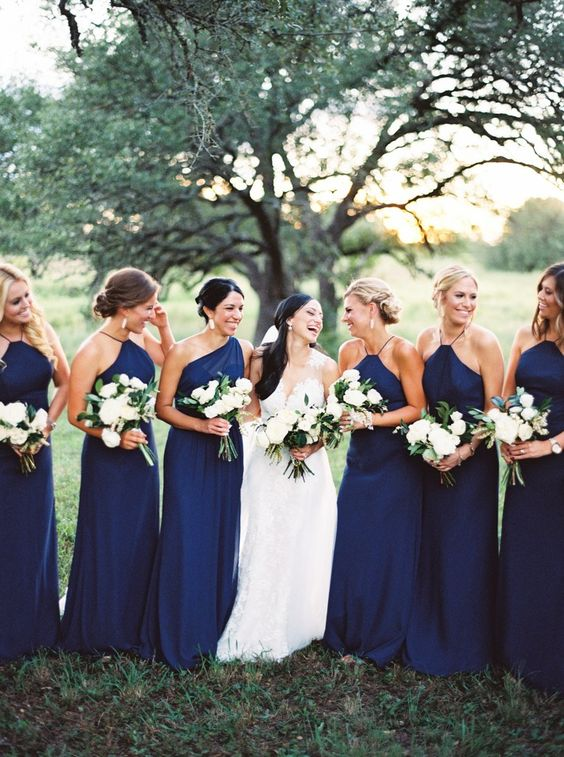 halter neckline and one shoulder navy bridesmaids' dresses are very elegant