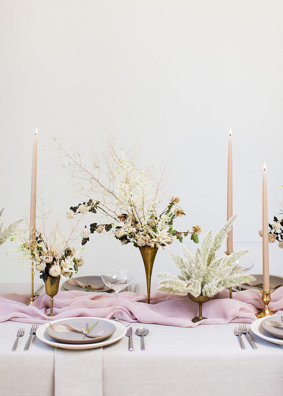 Fresh blooms were beautifully mixed with dried ones to create a textural and romantic table setting