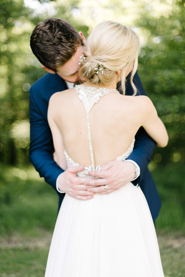 Look at that amazing racerback with embellishments and baby's breath in her hair