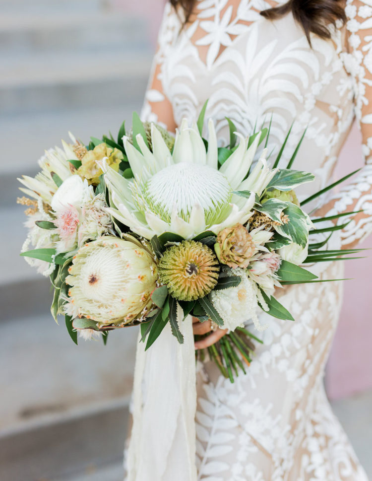 The bridal bouquet was done with king proteas, greenery and astilbe